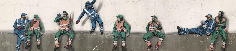 Arbejdere der er tegnet på en mur - som om de sidder på kanten
